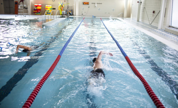 a person swims at the Student Recreation Facility