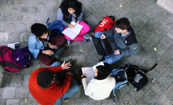 a group of students talk