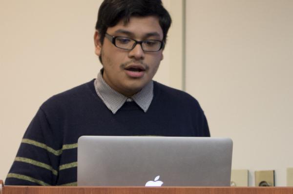 Student presenting at a podium