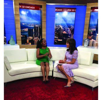 Dr. Christian talks with Sylvia Perez on set