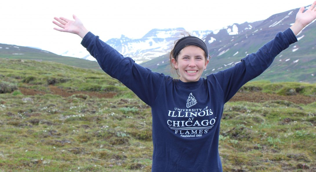 Leigha stands in a field in front of mountains